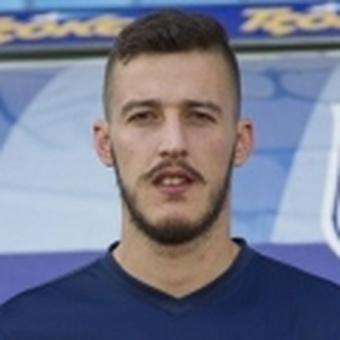 E. Giakos