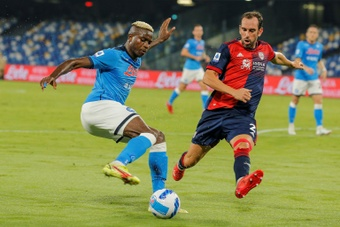 Napoli forward Victor Osimhen (L) is challenged by Cagliari defender. AFP