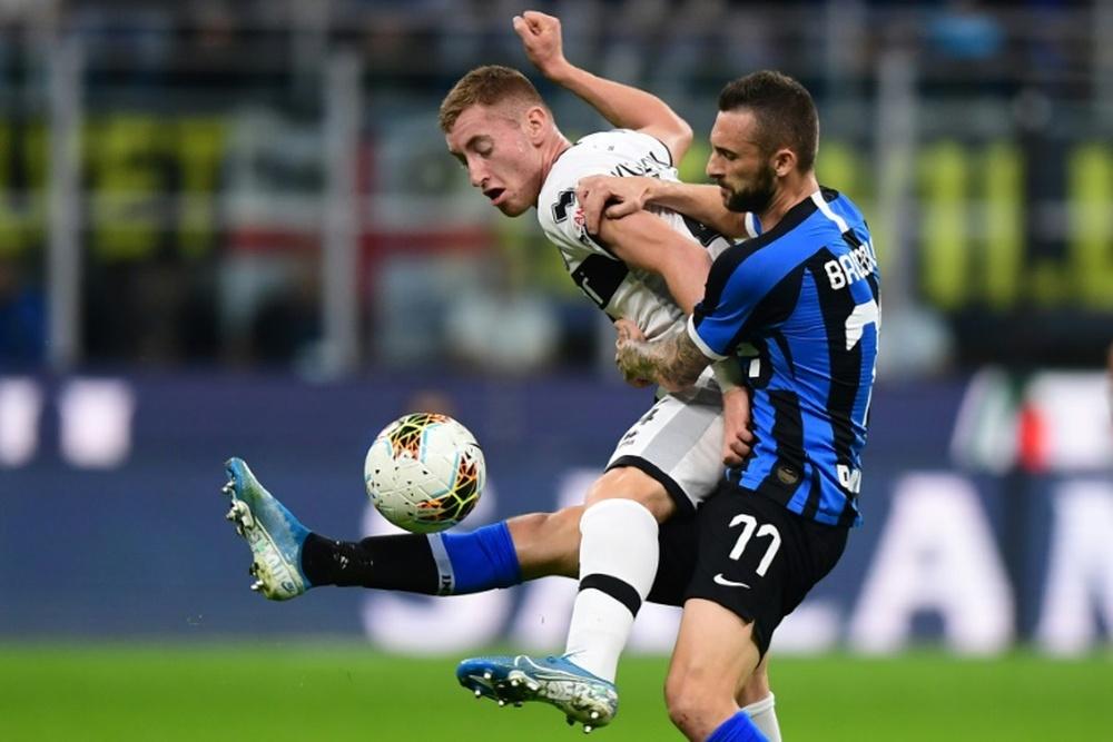 Tottenham et Manchester United suivent Brozovic. AFP