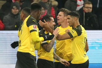 Dortmund mobbed Spanish forward Paco Alcacer after his late goal. AFP