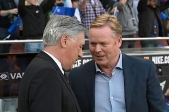Ancelotti had a nice gesture with Koeman. AFP