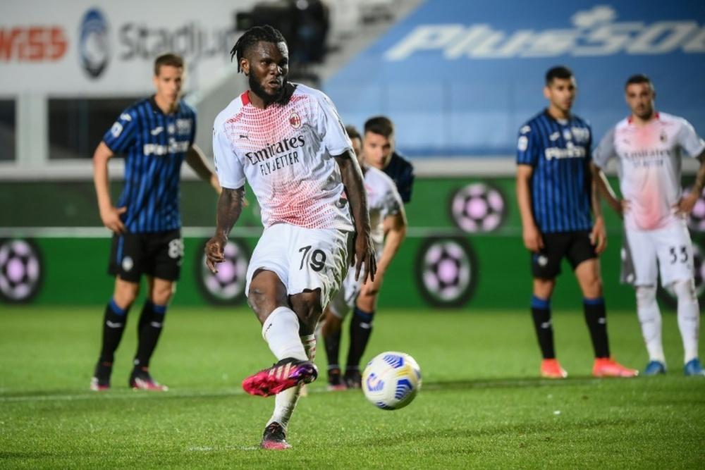 : Ivorian Franck Kessie (C) converts a second penalty for AC Milan in a 2-0 win over Atalanta. AFP
