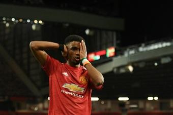 Manchester United's Amad Diallo celebrates scoring against AC Milan. AFP