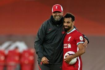 Jürgen Klopp y más elogios ¿para convencer a Salah de que siga? AFP