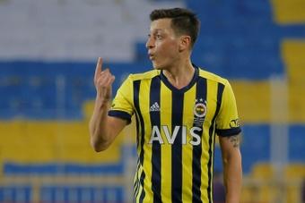 Ozil could return to England. AFP