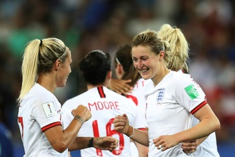White (r) scored both goals in England's victory over Japan to clinch top spot. AFP