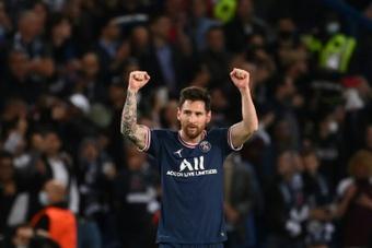 Patrice Evra tacle Leo Messi. AFP