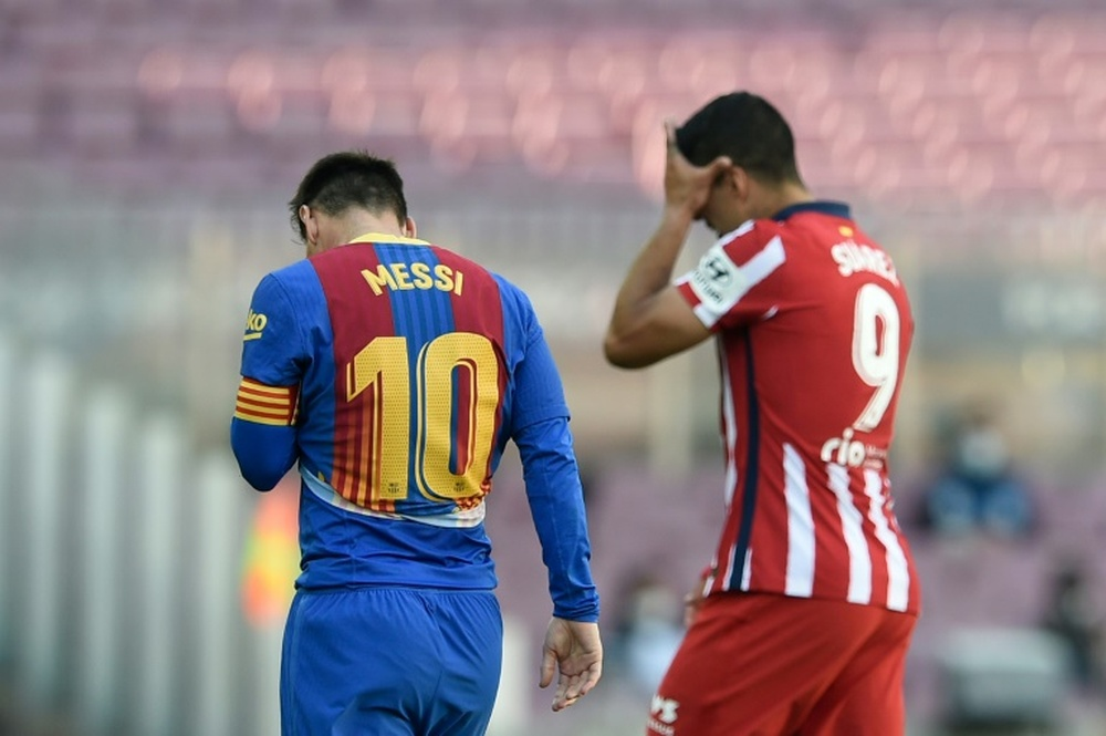 Suárez actuó de intermediario entre Messi y el Atlético para intentar su fichaje. AFP