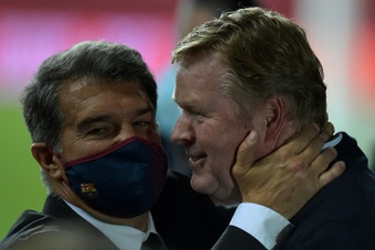 Laporta confirmed that Koeman will remain in charge of Barca. AFP
