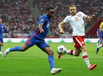 Kane marca um golaço, mas a Polônia arranca o empate nos acréscimos. AFP