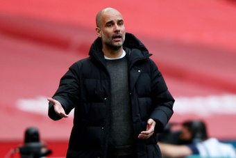 Pep Guardiola revealed a member of his staff was spat at by a Liverpool supporter. AFP