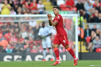 Firmino scored a hat-trick against Watford. AFP