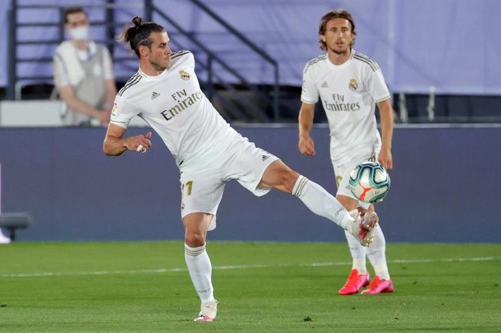 Bale não esquece o seu amor pelo golf. AFP