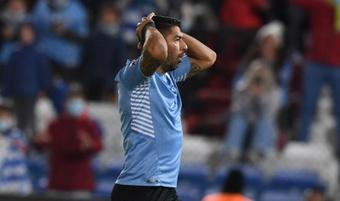 Suárez y Giménez salieron lesionados con Uruguay. EFE