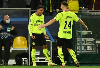 Donyell Malen (L) as Dortmund beat Sporting in Haaland's absence. AFP