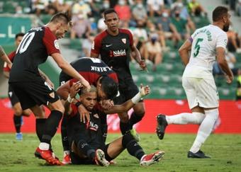 Youssef En-Nesyri (bottom) scored as Sevilla drew at Elche. AFP