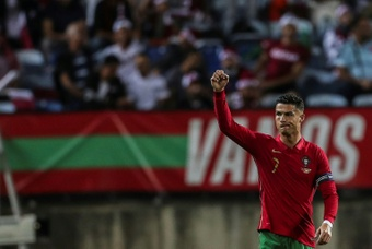 Cristiano Ronaldo celebrates after scoring against Qatar. AFP