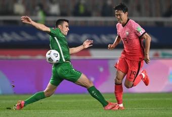Kim Young-gwon skips past Annadurdyyev Altymyrat of Turkmenistan. AFP