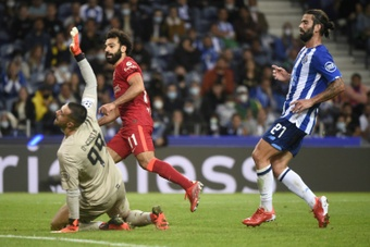 Liverpool thrash Porto to go top of the table with six points. AFP