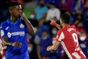 Luis Suarez scored a late double for Atletico. AFP