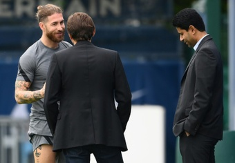 It is not known when Sergio Ramos (L) will make his PSG debut. AFP