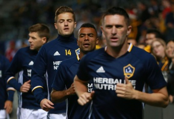 (From L) Steven Gerrard, Robbie Rogers, Ashley Cole and Robbie Keane of Los Angeles Galaxy warm up prior to their MLS match against DC United, at StubHub Center in Carson, California, on March 6, 2016
