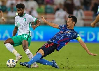 Maya Yoshida (R) confronted Saudi Arabia supporters after Japan lost 1-0. AFP