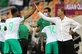 High-five for Saudi scorer Firas al-Buraikan from coach Herve Renard. AFP