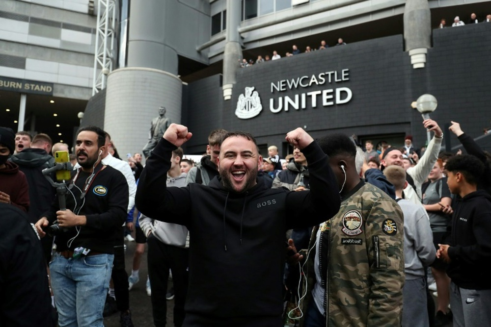 Newcastle fans are delighted by the takeover by a Saudi-led consortium. AFP