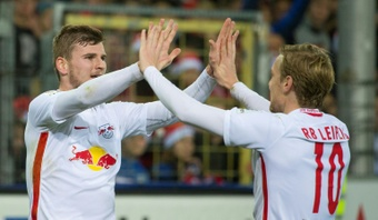 Leipzigs forward Timo Werner (L) celebrates with teammate forward Emil Forsberg after he scored during the German first division Bundesliga football match against SC Freiburg November 25, 2016