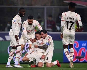 Milan beat nine-man Bologna to move top of Serie A. AFP