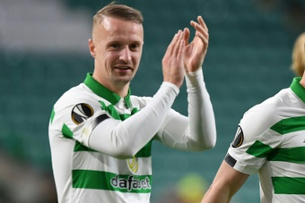 Leigh Griffiths has been charged by police for kicking a smoke bomb back into the crowd. AFP