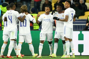 Vinicius was congratulated by his Real Madrid teammates after scoring twice. AFP