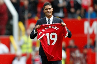 Solskjaer says Raphael Varane will relish the challenge of playing for Man Utd. AFP
