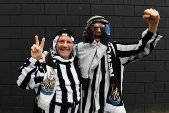 Newcastle have made a U-turn on calls to supporters not to wear Saudi clothing. AFP