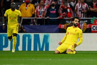 Mohamed Salah (R) scored the decisive goal in a cracking game with Atletico Madrid. AFP