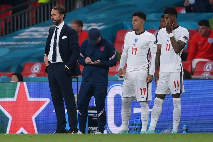 Gareth Southgate (L) got abuse after calling for young people to get vaccinated. AFP
