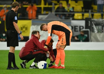 Neuer received treatment after the match against Dortmund. AFP