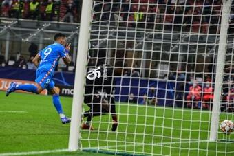 Luis Suarez sank AC Milan with a stoppage-time penalty. AFP