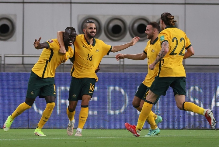 Awer Mabil celebrates with teammates after scoring the opener against China. AFP