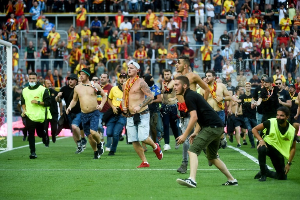 Lens beat Lille in derby blighted by pitch invasion. AFP