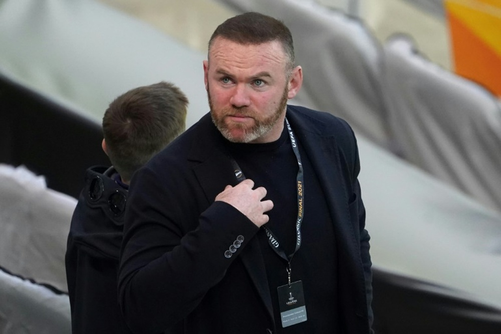 Wayne Rooney to stay with troubled Derby. AFP