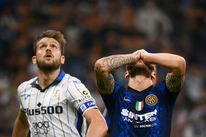 Federico Dimarco (R) missed a penalty for Inter versus Atalanta. AFP