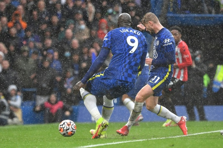 Timo Werner (R) scored as Chelsea beat ten man Southampton with two late goals. AFP