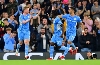 Manchester City midfielder Kevin De Bruyne celebrates scoring against Wycombe. AFP