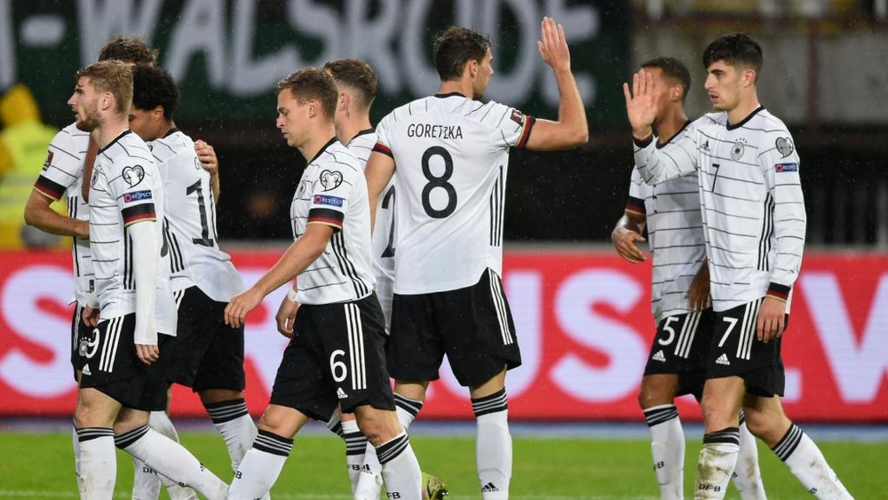 Flick hails 'perfect' result after victory over North Macedonia seals World Cup spot.