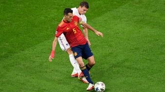 Luis Enrique hails pillar Busquets as Spain fall short in Nations League final.