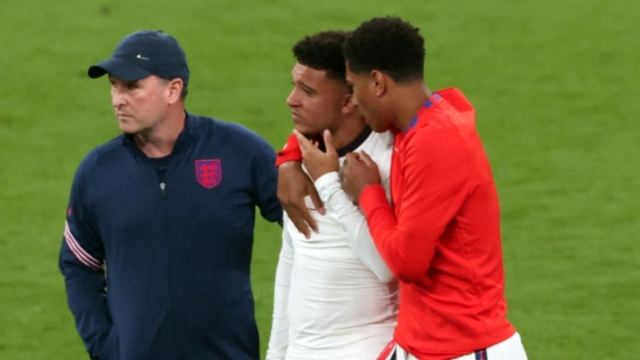 Bellingham consoles England team-mate Sancho after his penalty miss. GOAL