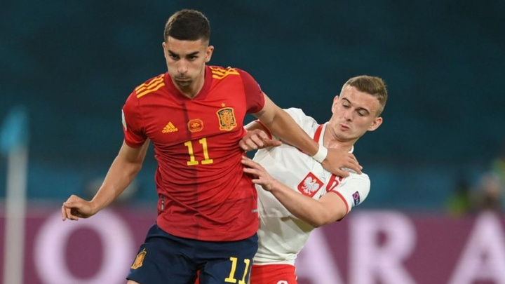 Kacper Kozlowski (R) made Euros history in Sevilla. GOAL