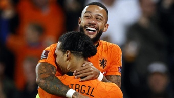 Memphis Depay and Virgil van Dijk celebrate a goal against Gibraltar. GOAL